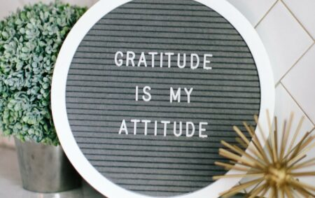 "This felt sign, ""Gratitude is my attitude"", represents business core values. Gratitude is a great example of a company standard that connects with customers and drives conversion."