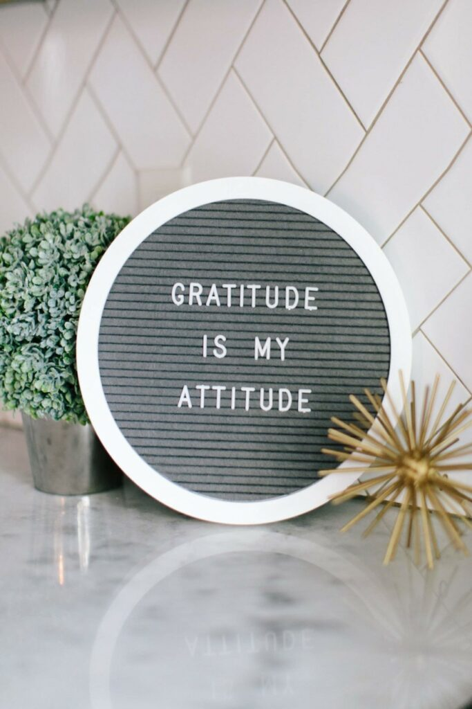 """This felt sign, """"Gratitude is my attitude"""", represents business core values. Gratitude is a great example of a company standard that connects with customers and drives conversion."""
